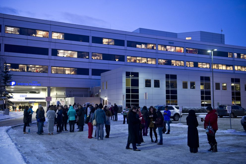 People stand outside Providence Alaska Medical Center after the quake. An earthquake caused damage in the Anchorage area on November 30, 2018. (Marc Lester / ADN)