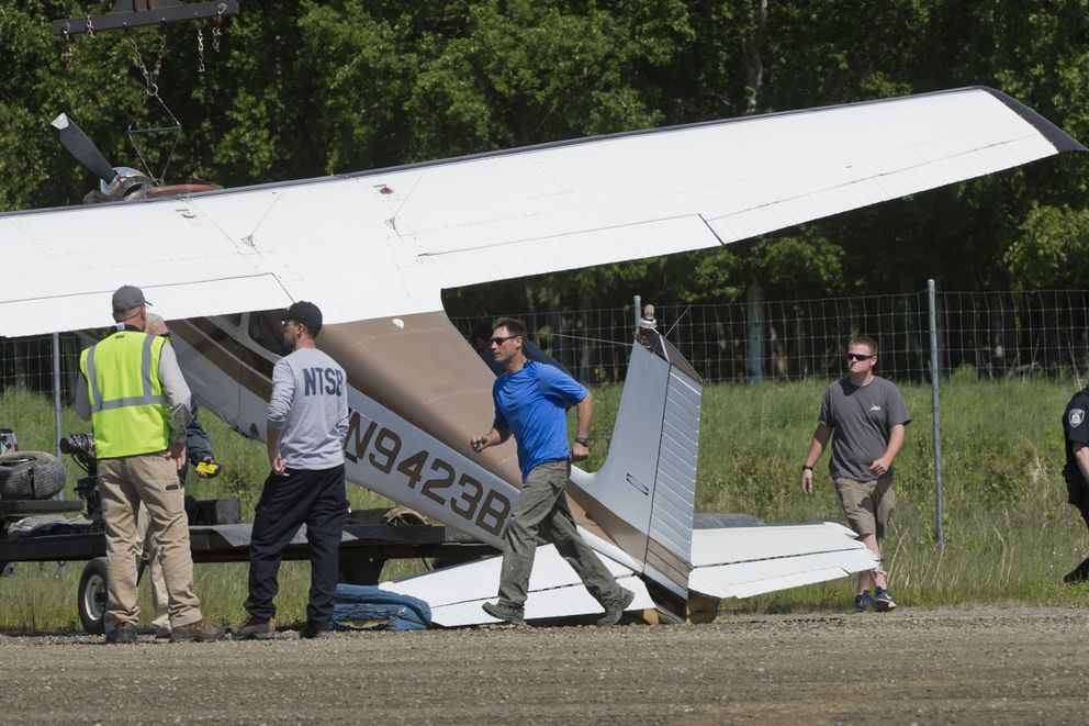 A damaged plane is loaded onto a trailer at the Lake Hood airstrip on June 13, 2018. A spokesman for the National Transportation Safety Board said the plane was involved in a midair collision near the mouth of the Susitna River. (Marc Lester / Anchorage Daily News)