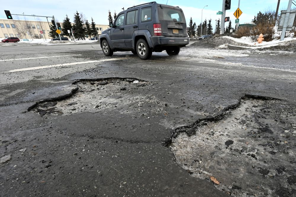 Large potholes at 26th Avenue and Minnesota Drive were filled by a pothole crew on Thursday, April 1, 2021. (Bill Roth / ADN)