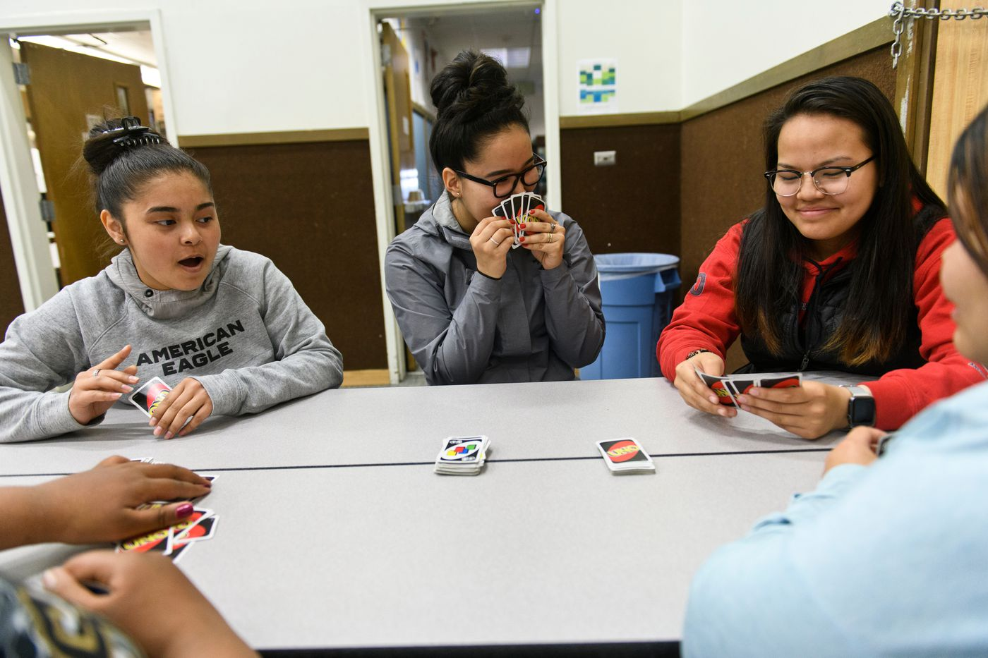 Akhiok senior Denise Kalmakoff plays a card game with other students during the lunch break of a school day on May 14. Seventh-grader Leilani Murillo is at left, and sophomore Teanna Amodo is at right. (Marc Lester / ADN)