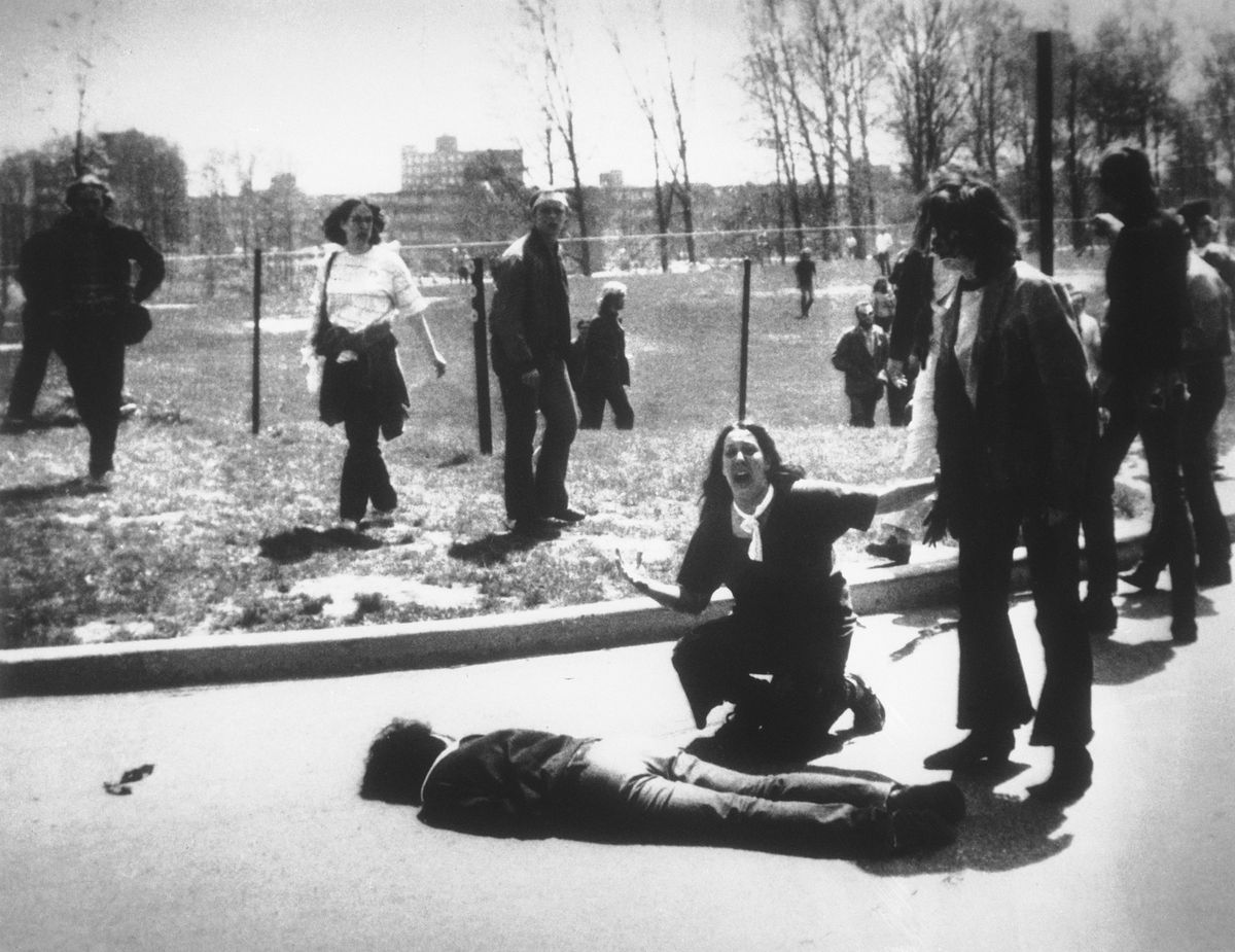 In this May 4, 1970 photo, Mary Ann Vecchio cries out as she kneels next to the body of student Jeffrey Miller on the campus of Kent State University in Ohio. National Guardsmen killed four when they fired into a crowd of young demonstrators protesting the U.S. bombing of Cambodia. (AP Photo/John Filo)