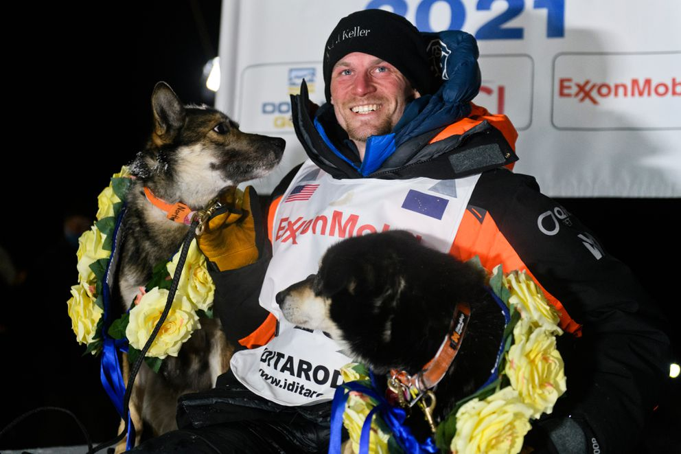 Dallas Seavey poses with his dogs North, left, and Gamble. Seavey arrived in Willow to win the 2021 Iditarod Trail Sled Dog Race on March 15, 2021. (Marc Lester / ADN)