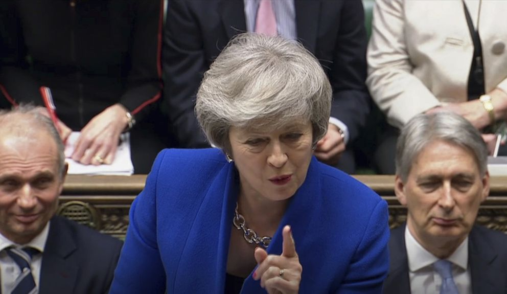 Britain's Prime Minister Theresa May speaks during Prime Minister's Questions in the House of Commons, London, Wednesday Jan. 16, 2019. In a historic defeat for the government Tuesday, Britain's Parliament discarded May's Brexit deal to split from the European Union, and May now faces a parliamentary vote of no-confidence later Wednesday. (House of Commons/PA via AP)