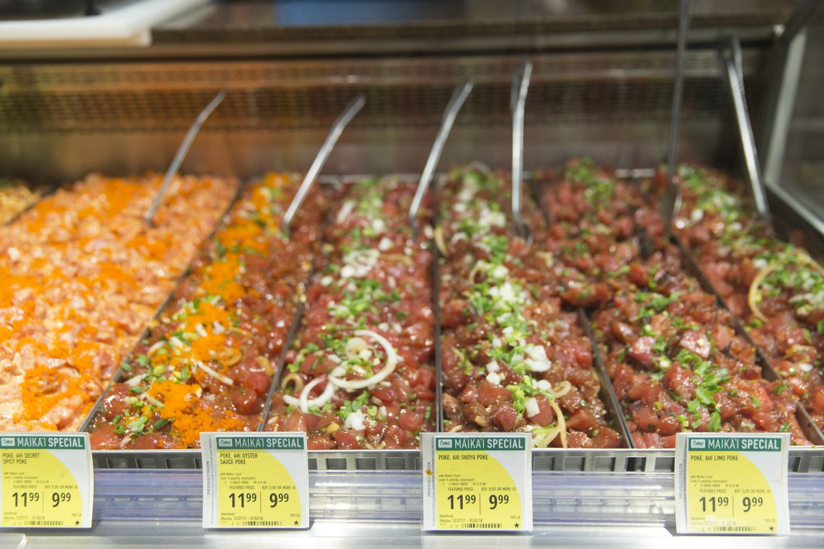 A selection of poke styles in Foodland Farms, at Ala Moana Shopping Center in Honolulu, Dec. 30, 2017. (Marco Garcia/The New York Times)