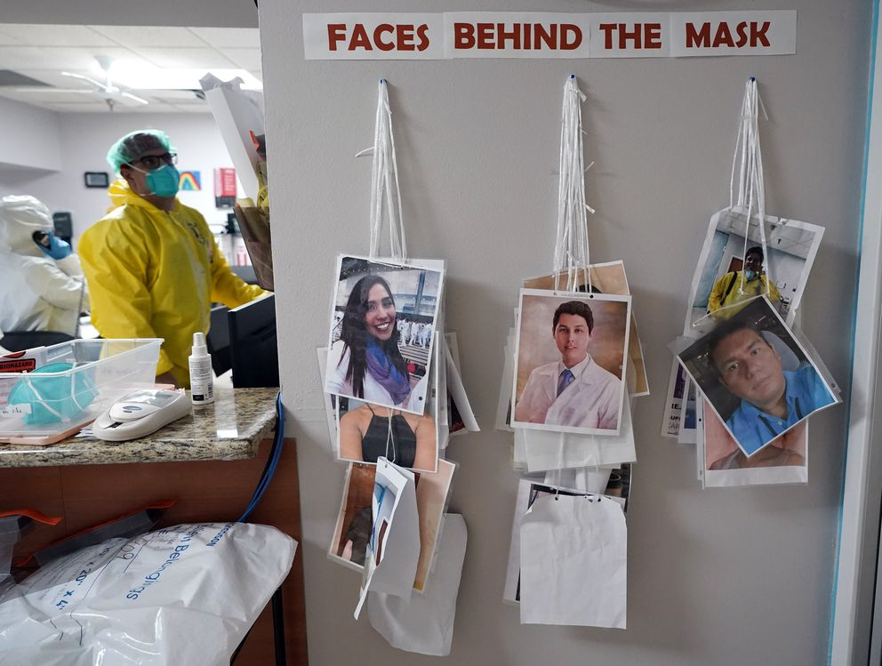 Photographs of staff working at the Coronavirus Unit at United Memorial Medical Center hang on the wall Monday, July 6, 2020, in Houston. The photographs help patients know who is behind the mask. (AP Photo/David J. Phillip)