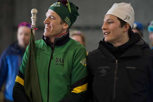 UAA's Sigurd Roenning, left, holds the Seawolves flag and stands with teammate JC Schoonmaker before both took their places places on the podium following the classic sprint races at the UAA Invitational cross country ski race at Kincaid Park on February 18, 2019. Roenning won the race and Schoonmaker took third. (Marc Lester / ADN)