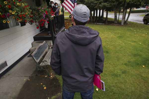 Rep. Lance Pruitt talks with a family in an east Anchorage neighborhood as he campaigns door-to-door for reelection to his seat in the Alaska Legislature on Sept. 15, 2020. (Emily Mesner / ADN)