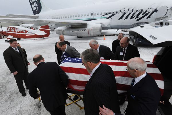 Hundreds of people attended the funeral for 96-year-old George Brown, a WWII veteran and founder of the Lucky Wishbone, Alaska's oldest single family-owned restaurant, at the Alaska Aviation Museum on Sunday, Feb. 11, 2018. (Bill Roth / ADN)