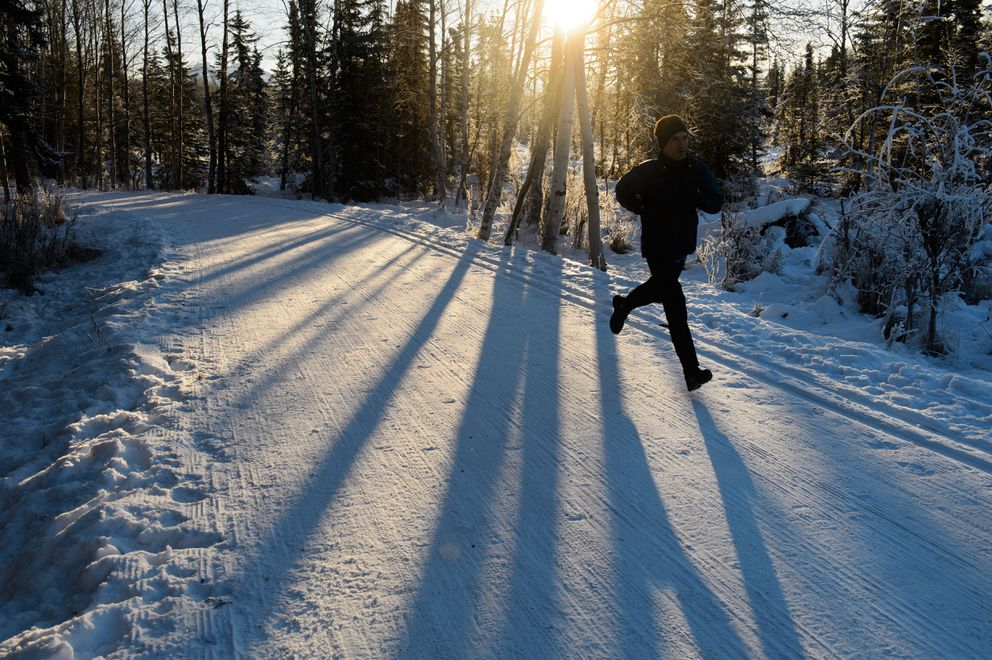 A runner heads west on the Chester Creek Trail near Lake Otis Parkway on January 17, 2019. (Marc Lester / ADN)