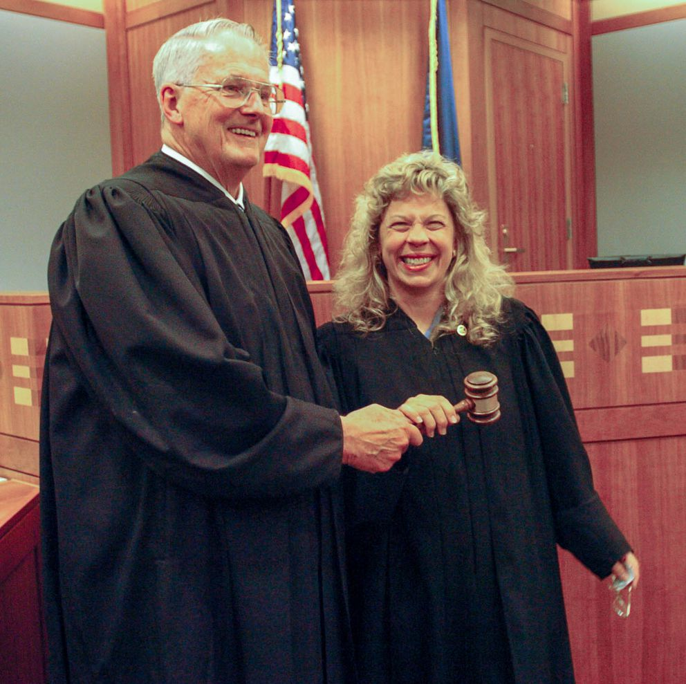 Judge Jim Wanamaker hands the gavel to the wellness court to Judge Stephanie Rhoades during a courthouse ceremony June 18, 2004. (Bob Hallinen / ADN Archive 2004)