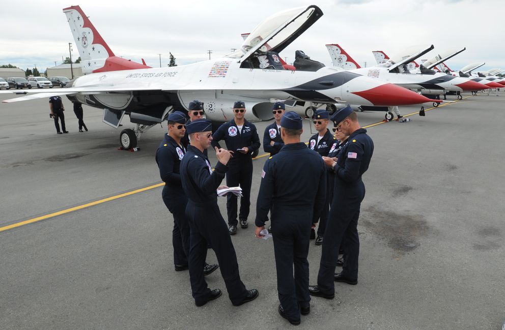 Pilots gather for a quick meeting after the U.S. Air Force Thunderbirds demonstration squadron arrived at Joint Base Elmendorf-Richardson.  (Bill Roth / ADN)