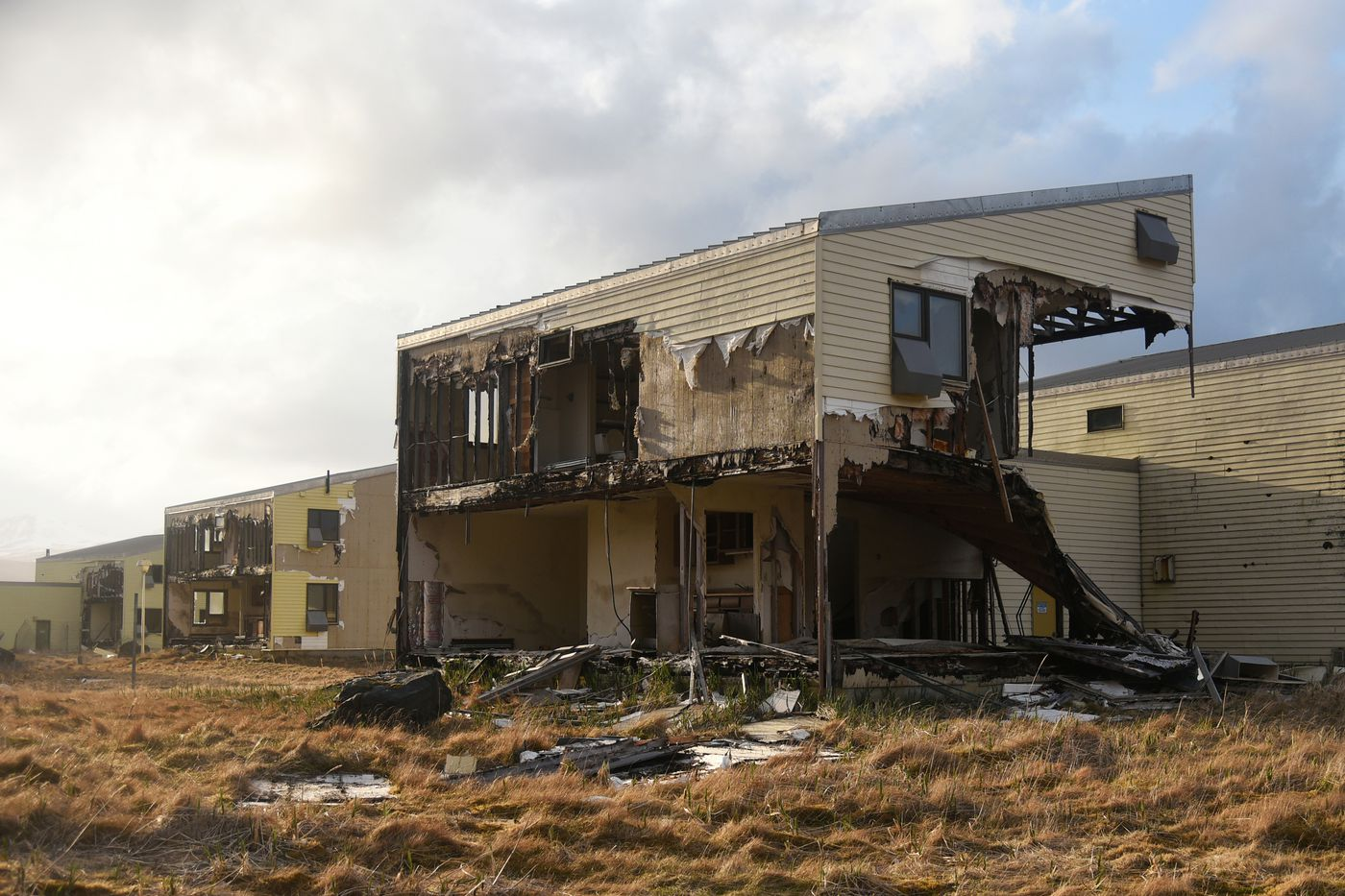 Abandoned housing in Adak, Alaska. The deterioration of structures in Adak has caused no shortage of frustration, sadness and finger-pointing. Determining responsibility — and paying — for cleanup in this remote community may become a contentious political issue in coming years. Photographed April 30, 2019. (Paxson Woelber)