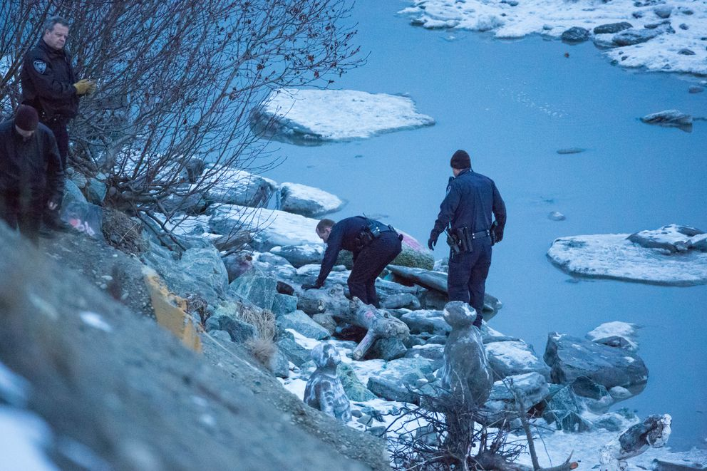 Anchorage police investigate the scene at Point Woronzof Jan. 28 after receiving a call reporting a deceased person on the beach nearby. An hour after arriving at the scene, police discovered another individual, who was taken to a hospital with critical injuries. (Loren Holmes / Alaska Dispatch News)