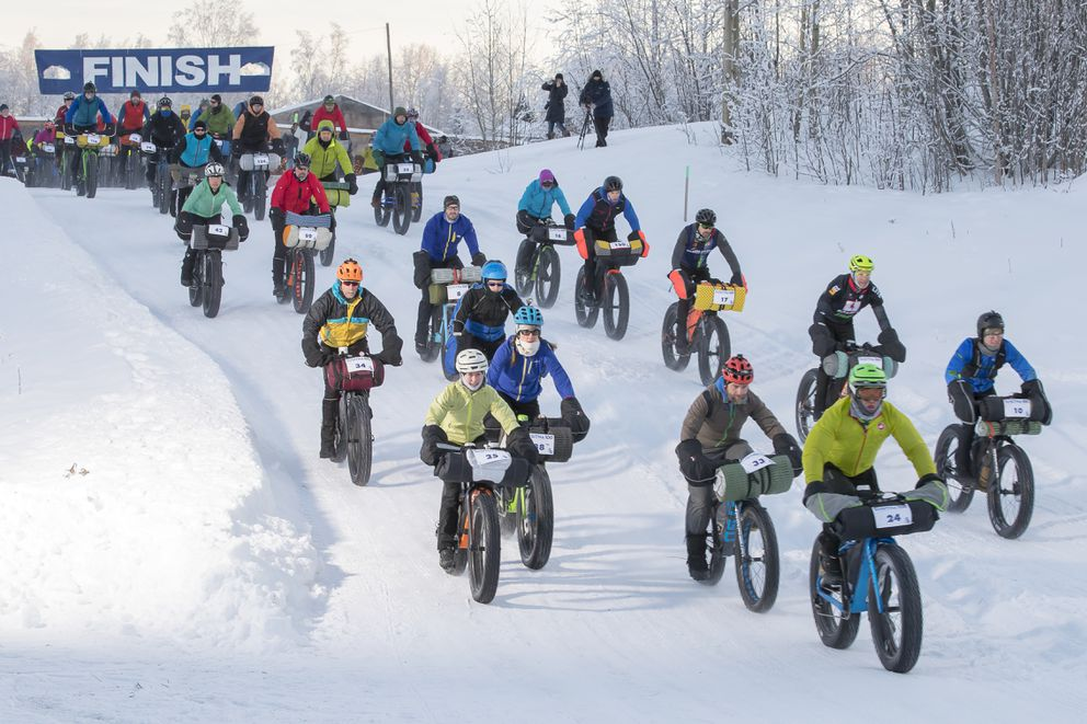 Riders begin the Susitna 100 Saturday at Martin Buser's Happy Trails Kennels. (Photo by Andy Romang)