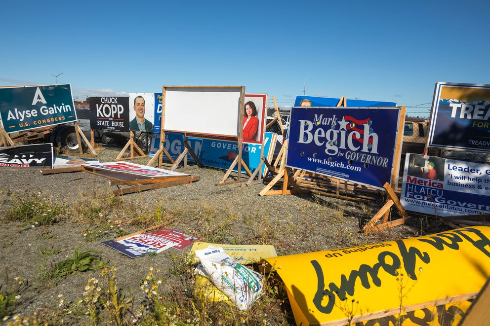 Political signs that were removed by the Alaska Department of Transportation sit in a DOT complex in Anchorage on Thursday. The signs were removed because they were illegally placed along road rights-of-way and posed a safety concern. (Loren Holmes / ADN)