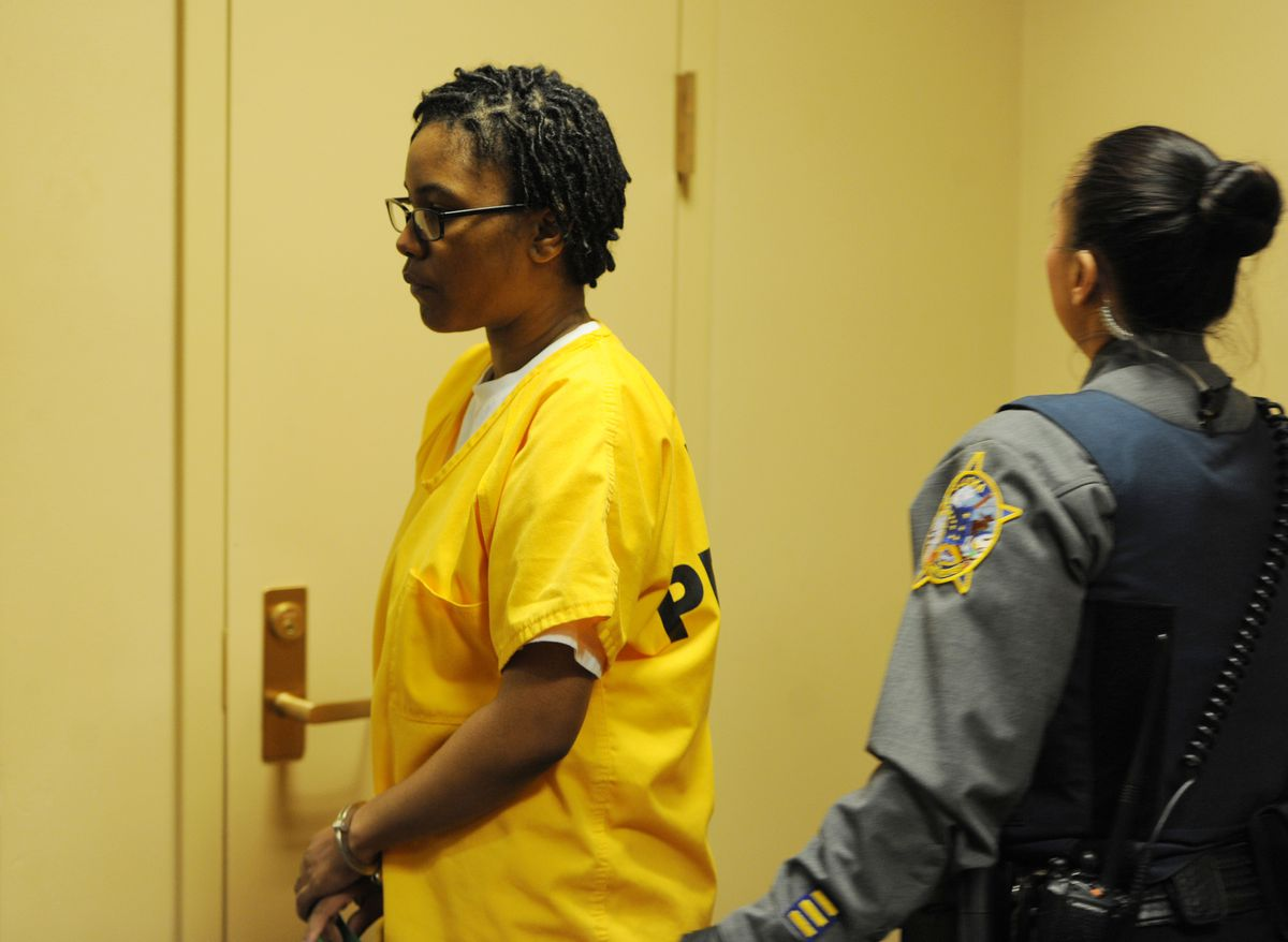 Ashley Ard walks into a courtroom at the Nesbett Courthouse on Wednesday. (Bill Roth/ ADN)