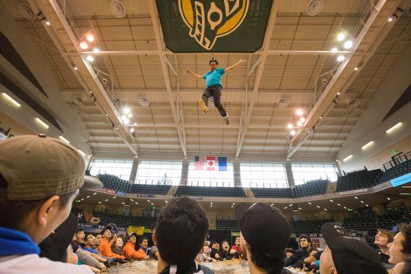David Thomas demonstrates the blanket toss during the Native Youth Olympics Friday, April 28, 2017 at the Alaska Airlines center. Five high school senior athletes were chosen to participate in the blanket toss, which is a traditional part of Nalukataq, the Inupiat whaling festival. (Loren Holmes / Alaska Dispatch News)