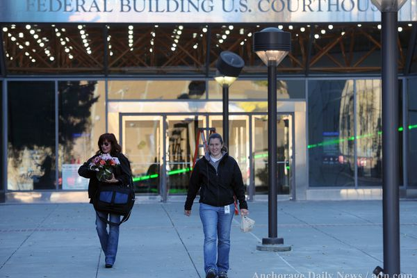 Furloughed workers leave the Federal Building and U.S. Courthouse in Anchorage during the federal government shutdown on Tuesday, October 1, 2013.