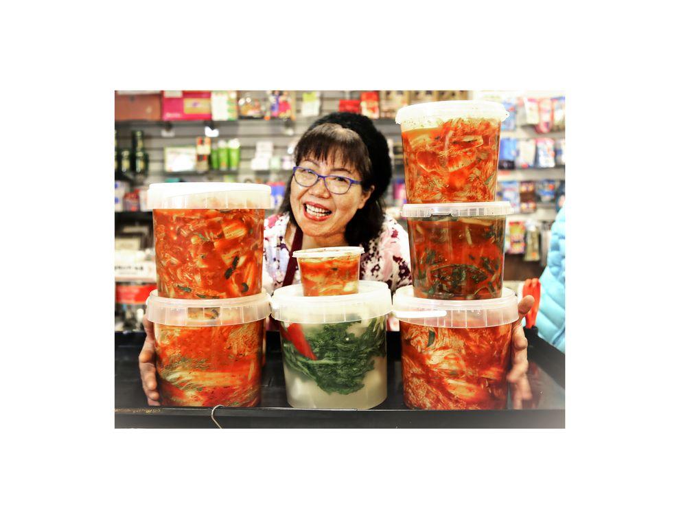 Hyun Yoo behind the counter at New Central Market. (Rejoy Armamento / Alaska Dispatch News)