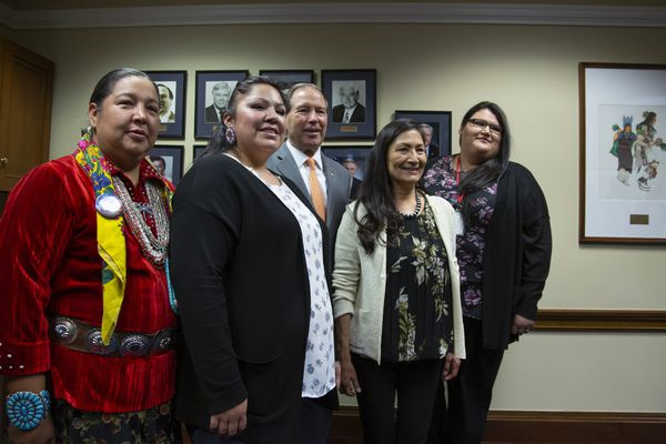From left, Amber Crotty from Window Rock, Ariz., a delegate of the Navajo Nation Council, Lissa Loring, from the Blackfeet Reservation in Montana, Vice Chair of the Senate Committee on Indian Affairs Sen. Tom Udall, D-N.M., Rep.-elect Deb Haaland, D-NM, the first Native American woman elected to Congress, and Kimberly Loring, of the Blackfeet Reservation in Montana, meet before the start of an Indian Affairs hearing to examine concerns about investigations into the deaths and disappearance of Native American women, on Capitol Hill in Washington, Wednesday, Dec. 12, 2018. (AP Photo/J. Scott Applewhite)