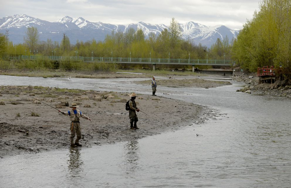 Fishers ply the waters of Ship Creek on Wednesday. (Bob Hallinen / Alaska Dispatch News)