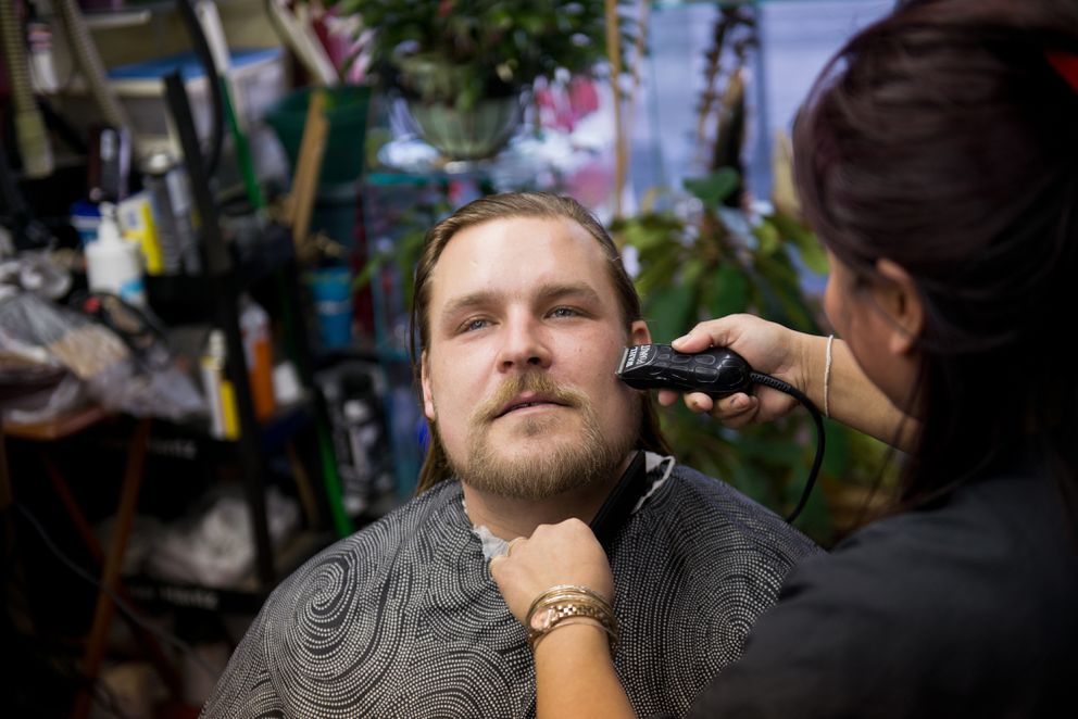 "Tom Kehrberg gets his beard trimmed and his hair cut by Bunn Yeesaeng on Tuesday, December 8, 2015. Tom Kehrberg, who had been living homeless in Anchorage since mid-2014, said he's decided to make some changes to his lifestyle since falling in love and planning to marry Barb Towarak. ""I got a long way to go. I got to climb that ladder again, right?"" he said. ""I know. I'm aware of it."""