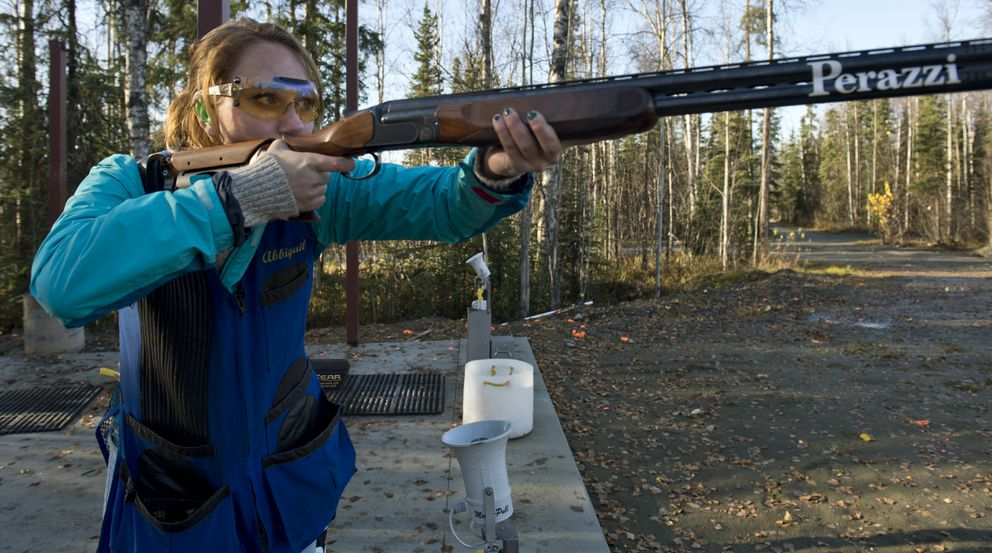 Fifteen-year-old Abbigail Lynn of Anchorage fires as a target emerges from the underground trapshoot bunker at Birchwood Recreation and Shooting Park. (Marc Lester / Alaska Dispatch News)