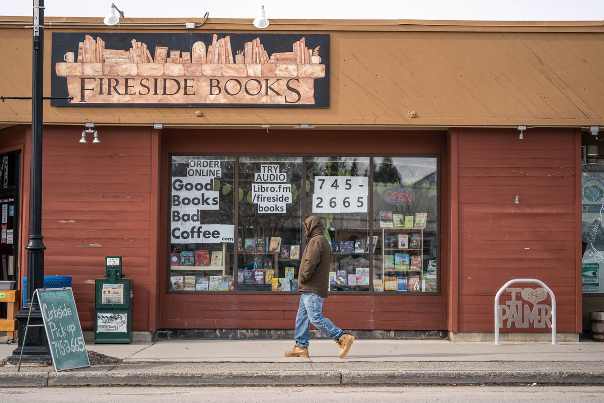 A person walks past Fireside Books in downtown Palmer on Wednesday, April 8, 2020. The store was receiving numerous orders for five books the Mat-Su school board voted off English reading lists this week. (Loren Holmes / ADN)