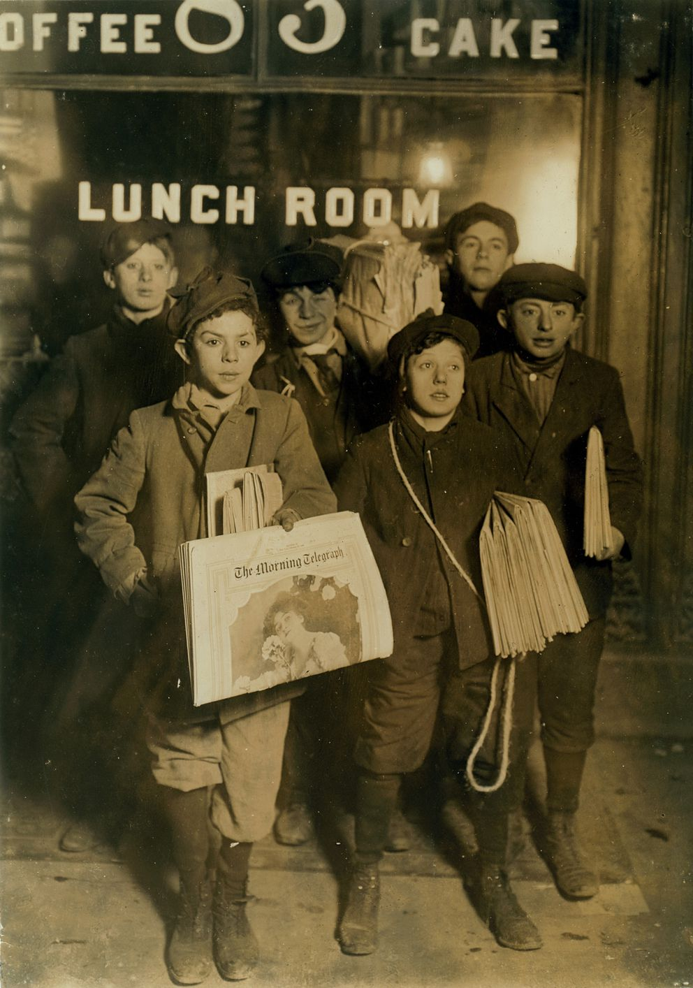 Newsboys selling on Brooklyn Bridge. Sunday, February 23rd, 1908. Photo by Lewis W. Hine (Library of Congress)