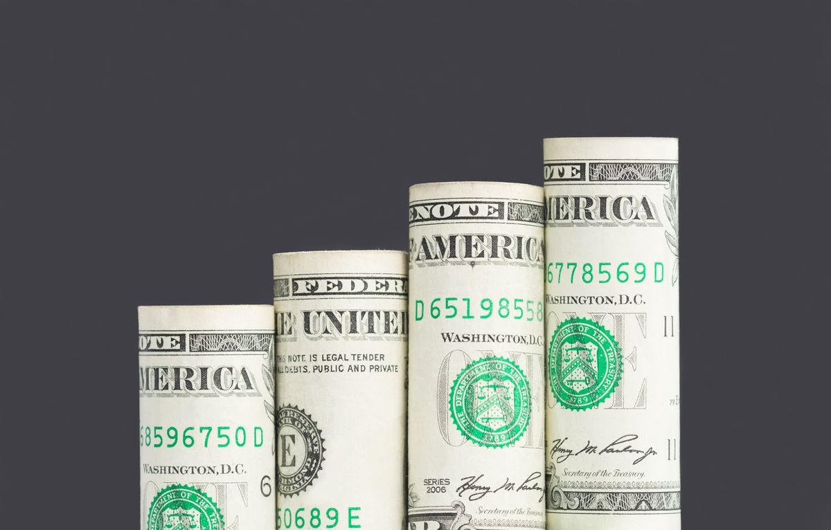 Growing bar graph from US dollar banknotes, stacked diagram