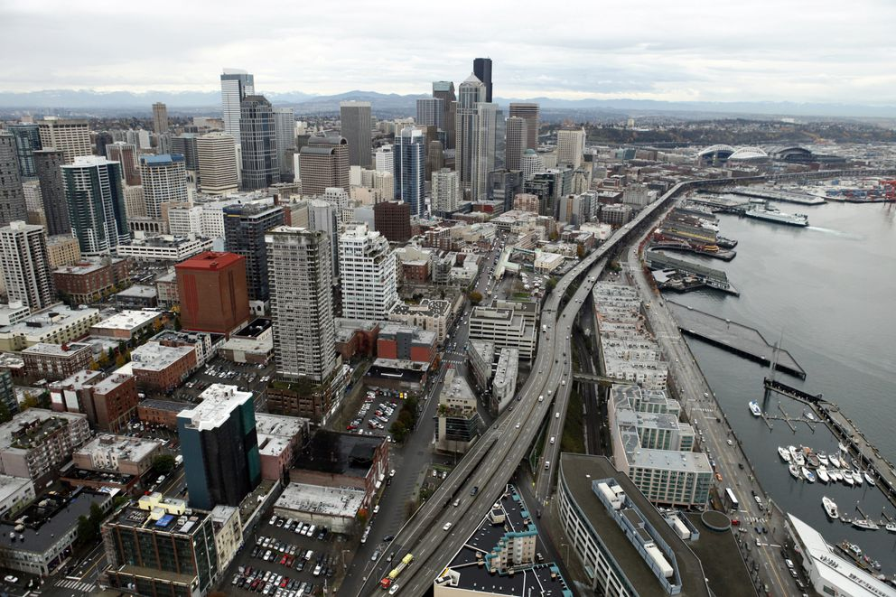 In this Nov. 19, 2009, photo, the Alaskan Way Viaduct is seen as it runs from near the football and baseball stadiums, upper right, and though downtown near the Elliott Bay waterfront in Seattle. The highway along Seattle's waterfront is set to shut down for good Jan. 11, 2019, ushering in what officials say will be one of the most painful traffic periods in the city's history. The 65-year-old viaduct is being replaced by a four-lane Highway 99 tunnel, scheduled to open several weeks after the viaduct's closure. (AP Photo/Elaine Thompson)