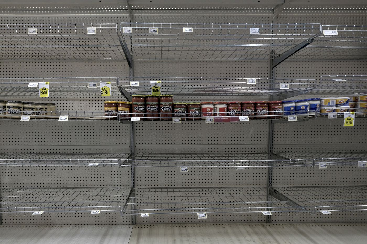 Empty shelves at the grocery store in Nuiqsut. Groceries are expensive in remote Alaskan villages and supplies take time to ship. The chips that lined these shelves have been out of stock for more than a month. (Washington Post photo by Bonnie Jo Mount)