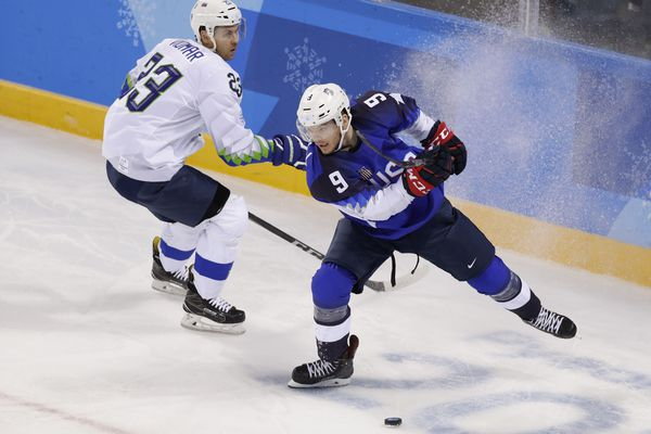 American Brian O'Neill (right) tries to keep the puck away from Slovenia's Luka Vidmar, a former UAA skater, in a preliminary round hockey game Wednesday, Feb. 14, 2018, at the Kwandong Hockey Centre, Gangneung, South Korea. (David W Cerny / Reuters)