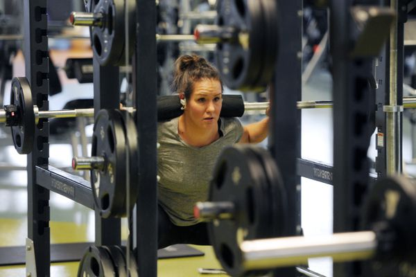 Dana Jack works out at the YMCA of Alaska on Lake Otis Parkway during the COVID-19 pandemic on Thursday, May 21, 2020. Jack said, 'I'm getting used to lifting again and getting back to where I was.' (Bill Roth / ADN)