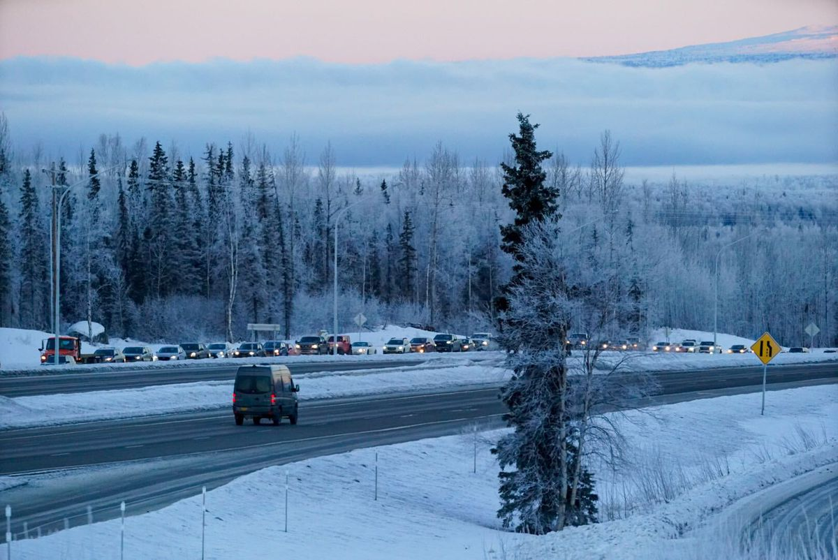 Traffic is backed up on the southbound frontage road between the south Eagle River and Hiland Road exits on the Glenn Highway on Saturday, Jan. 2, 2021 while Anchorage police conduct a death investigation. (Loren Holmes / ADN)