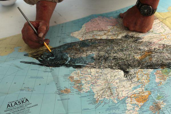 A gyotaku print of a salmon on a 1975 National Geographic map of Alaska. (Photo by Steve Meyer)