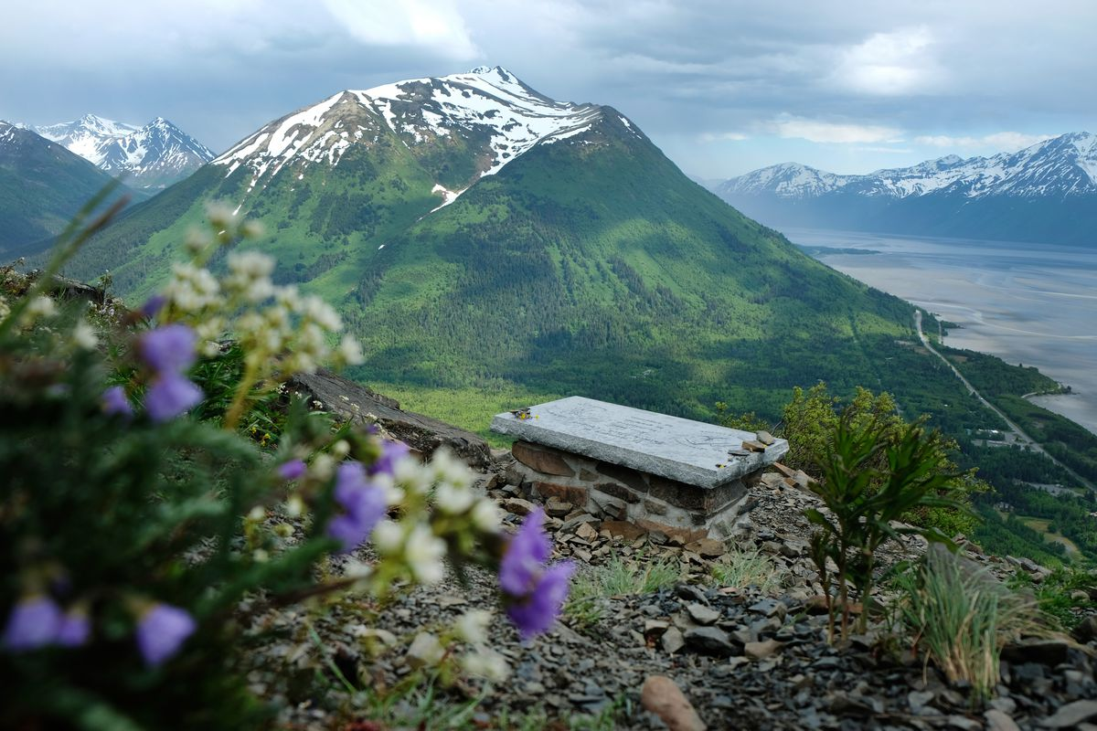 A memorial bench for Jack Cooper overlooks Bird Creek and Turnagain Arm from a point midway up the Bird Ridge trail. (Marc Lester / ADN)