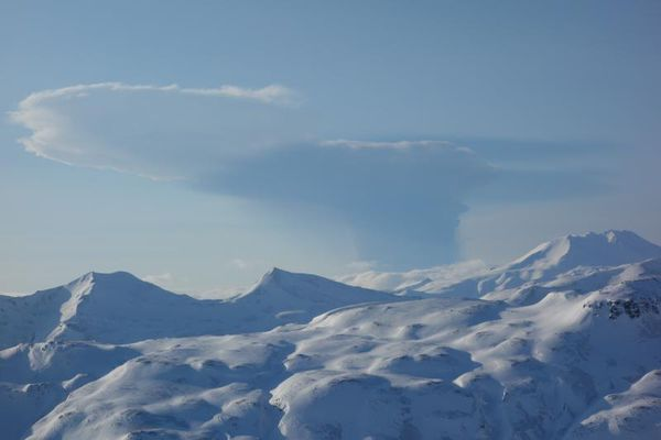 February 19, 2017, Bogoslof eruption plume as seen from Unalaska Island, 53 miles ESE of Bogoslof volcano. Photo taken from helicopter during fieldwork by AVO geologists at 5:22PM, approximately 14 minutes after the start of the eruption. (Janet Schaefer / Alaska Volcano Observatory)
