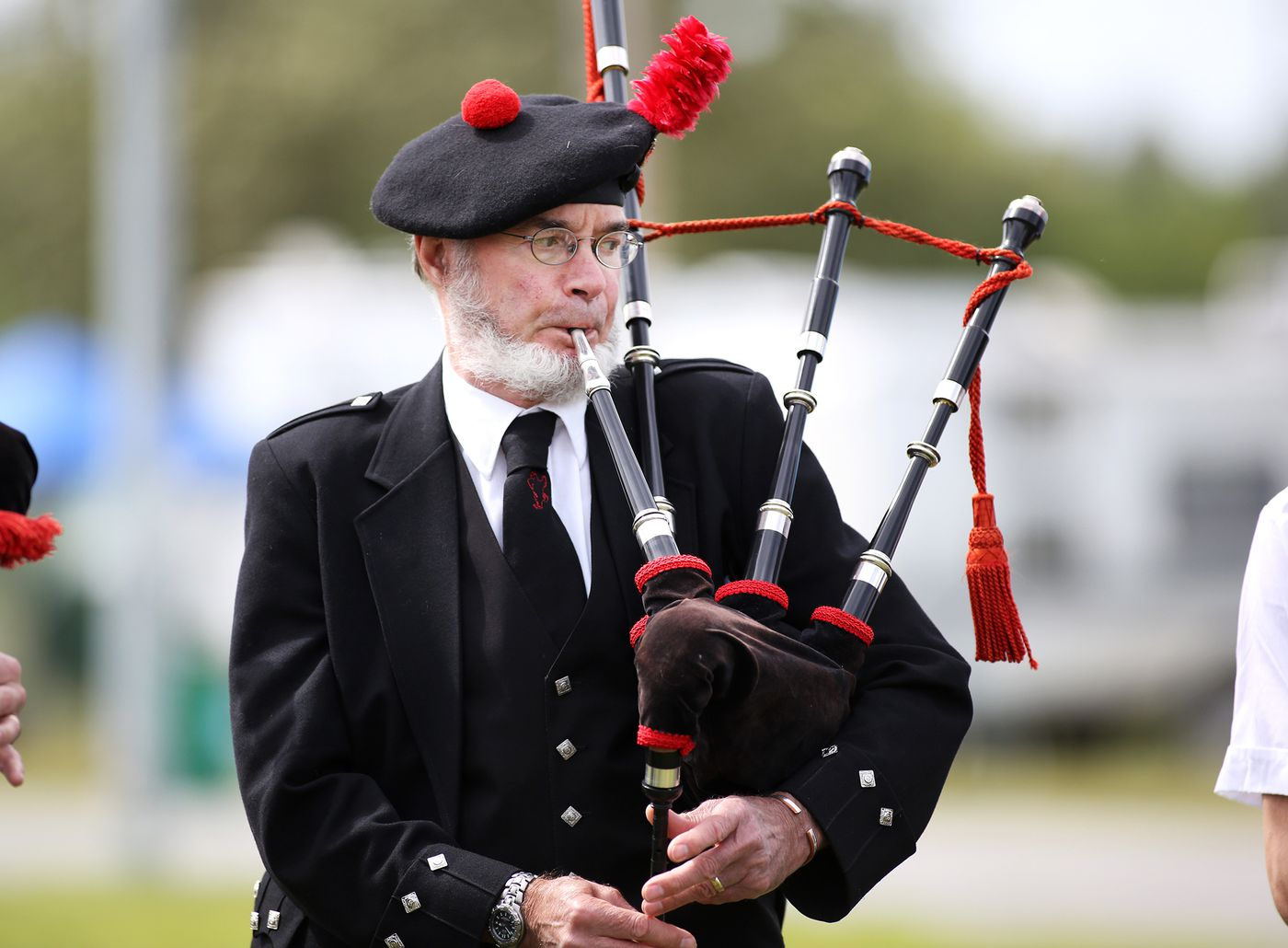 Dennis Stephens plays the bag pipe with the Fairbanks Red Hackle Pipe Band during the 2015 Alaska Scottish Highland Games on Saturday June 27, 2015 at the Alaska State Fair grounds.