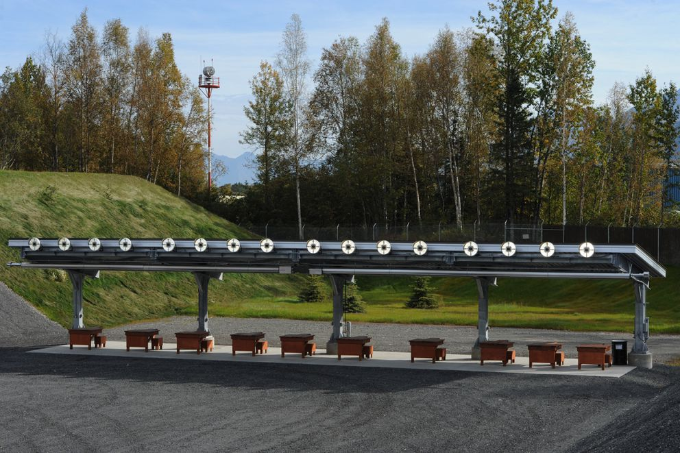 Lighting and heaters are placed above shooting benches at the 300-yard range at new Anchorage Police Department shooting range named in honor of retired APD Sgt. Ted Smith, who died in an airplane crash in 2013. (Bill Roth / ADN)