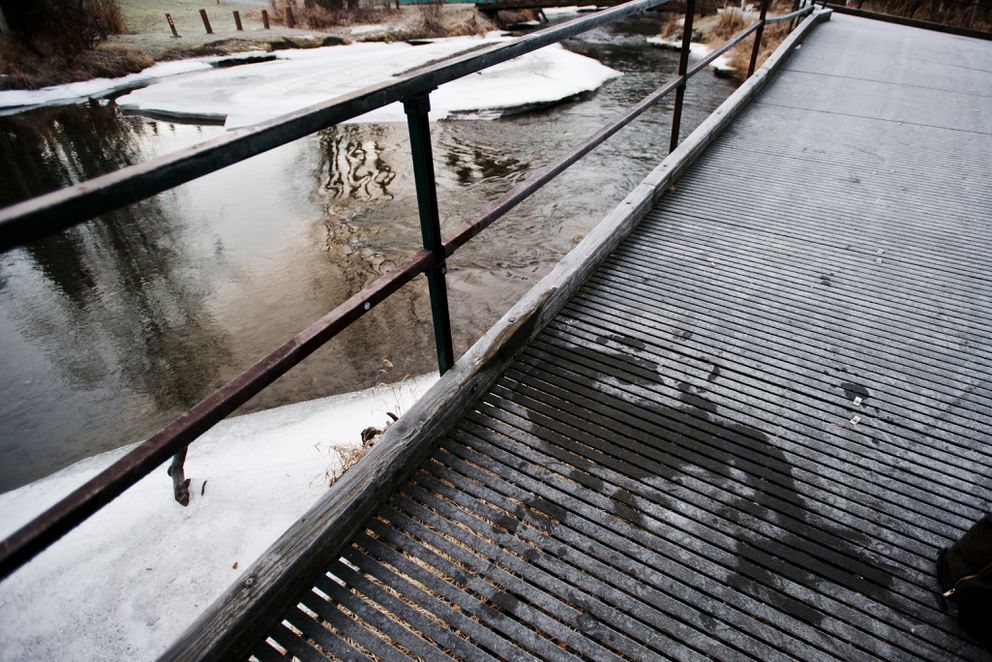 A melted area of frost on the decking of a viewing platform at Campbell Park shows where a man was sleeping. The Deck, as it is known, is a popular drinking spot for homeless people in the area. Photographed on Tuesday, December 9, 2014. (Marc Lester / Alaska Dispatch News)