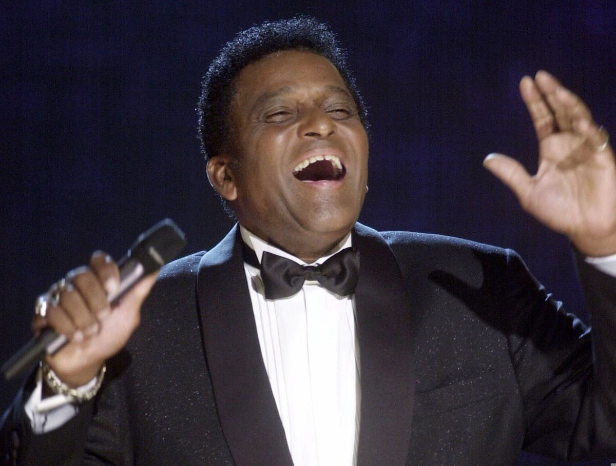 In this Oct. 4, 2000, file photo, Charley Pride performs during his induction into the Country Music Hall of Fame at the Country Music Association Awards show at the Grand Ole Opry House in Nashville, Tenn. (AP Photo/Charlie Neibergall, File)