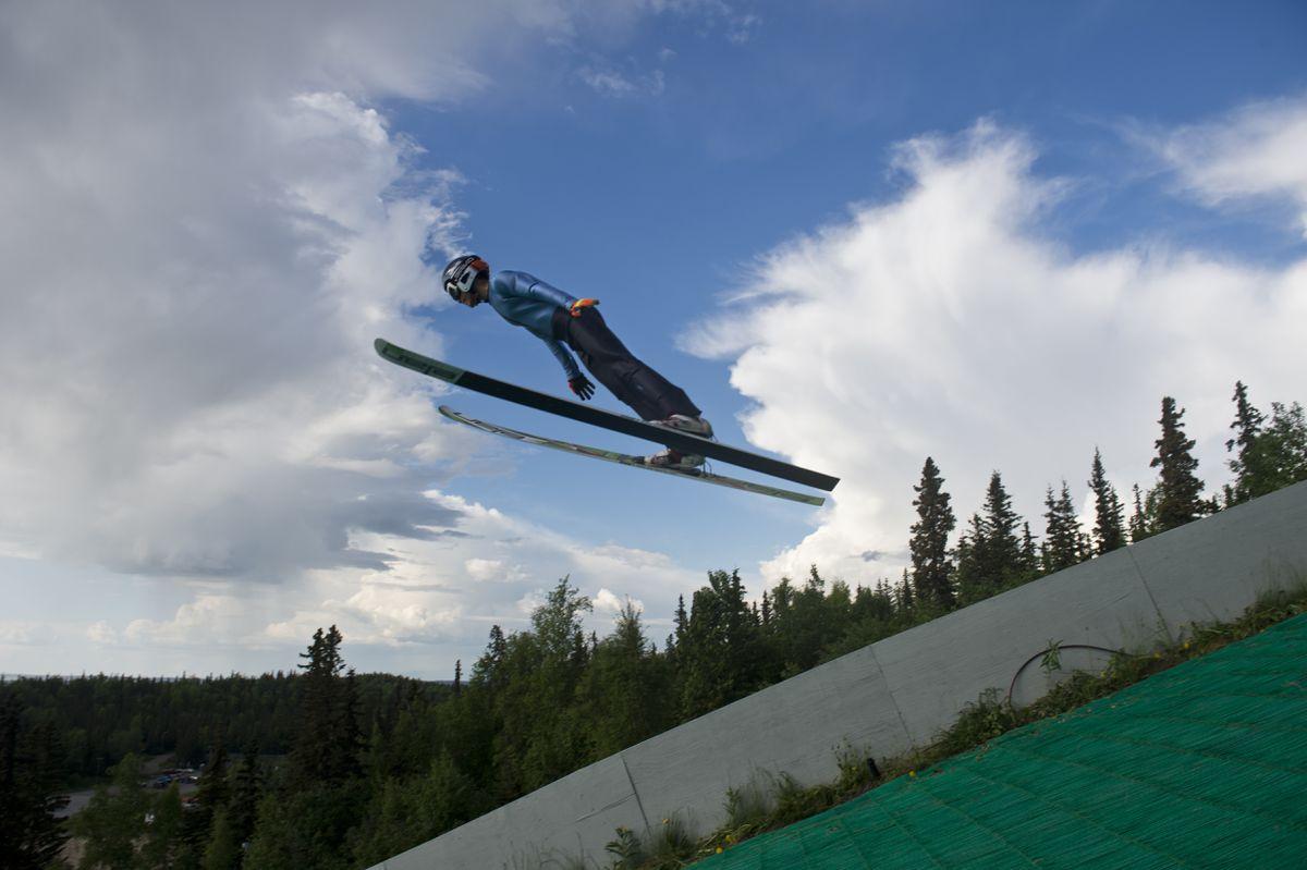 Carter Brubaker, of Anchorage, flies over the 65-meter ski jump at the Karl Eid Ski Jump Complex. (Marc Lester / ADN)