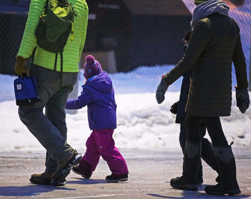 Parents and guardians bring their children to Inlet View Elementary School as students return to in-person learning in Anchorage on Wednesday, Jan. 20, 2021. (Emily Mesner / ADN)