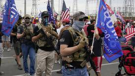 Armed protesters outside vote-counting centers become an increasingly typical sight