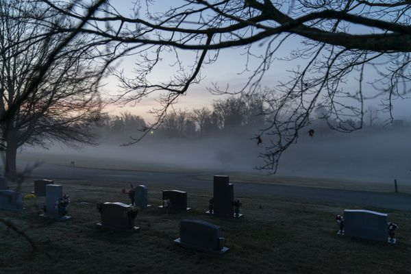 FILE - In this Wednesday, March 17, 2021 file photo, morning fog blankets a cemetery in West Virginia. The number of U.S. suicides fell nearly 6% in 2020 amid the coronavirus pandemic — the largest annual decline in at least four decades, according to preliminary government data. (AP Photo/David Goldman)