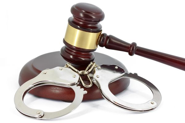 Handcuffs and gavel (Thinkstock)