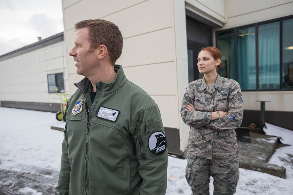Lt. Col. John Rogers and Staff Sgt. Samantha Glenny look at the airfield from next to the Joint Base Elmendorf-Richardson Base Ops building on Friday, Dec. 7, 2018. When Friday's magnitude 7.0 earthquake hit, Rogers, the squadron commander, was in a F-22 simulator and Staff Sgt. Samantha Glenny jumped into action coordinating efforts to re-open the airfield. (Loren Holmes / ADN)