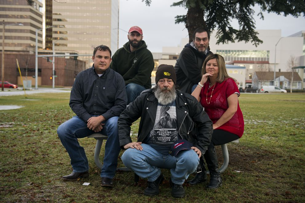 Members of the Alaska A-Team include, from left, Chad Martin, Daniel Miller, Floyd Hall, Damion Turchetto and Candis Bishop. The Alaska A-Team's mission is to track down stolen vehicles in Anchorage, using the power of social media and tips from the public. Photographed Nov. 27, 2018, in Anchorage. (Marc Lester / ADN)