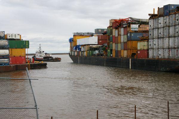 The last Alaska Marine Lines ocean-going barge of the year for Bethel, Alaska, lands Tuesday, Sept. 27, 2016, at the city dock. (Lisa Demer / Alaska Dispatch News)
